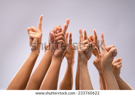 Hand of people pointing at the sky - stock photo