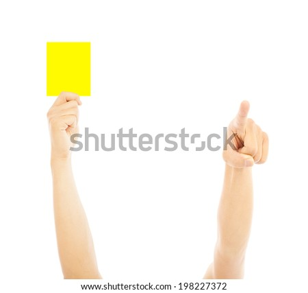 Hand of referee with yellow card to warn - stock photo