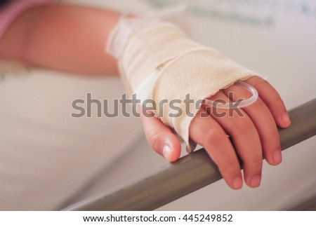 hand of sick Little girl in hospital bed with IV.set .,Little girl I.V. patients. - stock photo