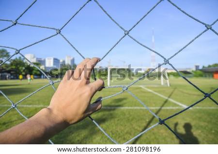 Hand of soccer park - stock photo