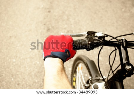 Hand of the bicycle racer - stock photo