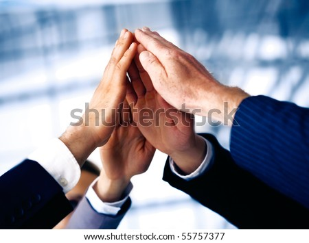 Hand of the business people forming a pyramid in the air. - stock photo