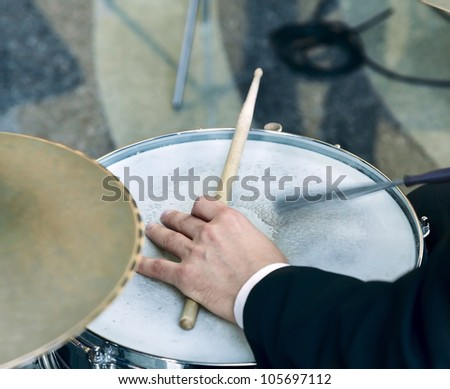 Hand of the drummer playing on drum set - stock photo