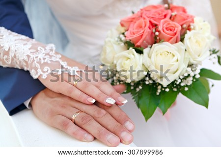 Hand of the groom and the bride at a wedding party  - stock photo