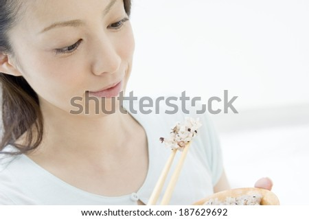 hand of woman eating boiled rice