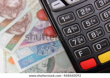 Hand of woman using payment terminal, enter personal identification number, credit card reader, polish currency money, finance and banking concept