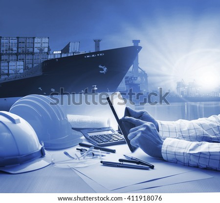 hand of working man in shipping ,logistic freigh cargo transport business blue theme - stock photo
