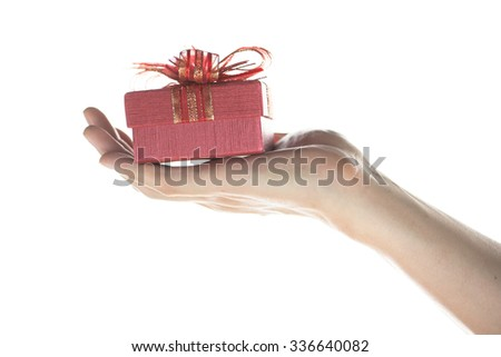 Hand of young man giving and presenting a gift to someone