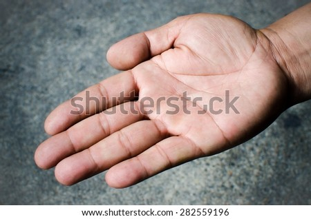 Hand of young man on gray background