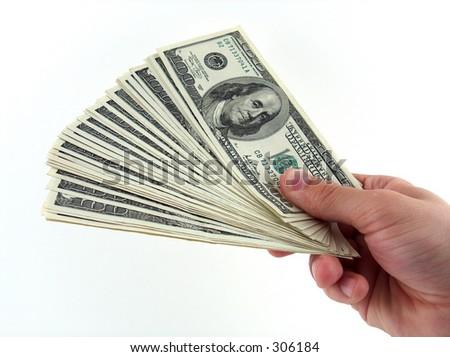 hand offering big amount of money - stock photo