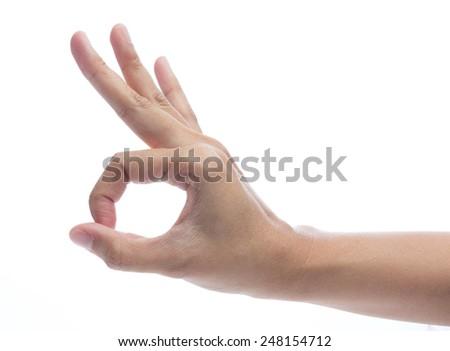 Hand OK sign isolated on white background - stock photo