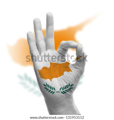 hand OK sign, wrapped in the flag of Cyprus - stock photo