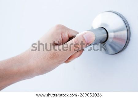 Hand on a door handle to open the door - stock photo