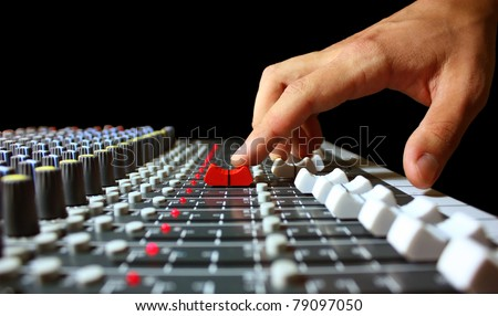 Hand on a mixer, operating the leader - stock photo