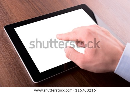 hand on a touch screen of tablet computer, with clipping path - stock photo