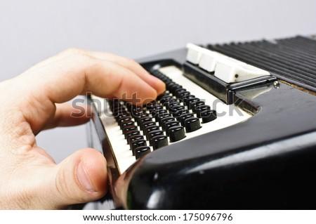 Hand on accordion close up - stock photo