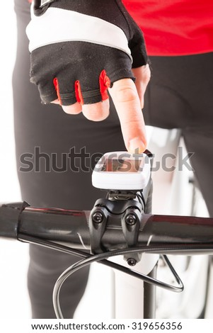 hand on bicycle computer - stock photo