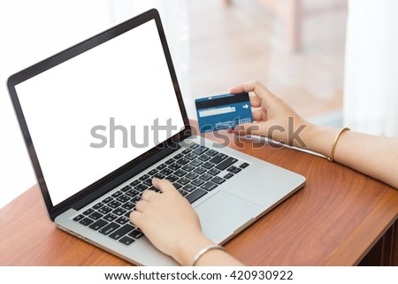 Hand on computer notebook fill credit card data with copy space.