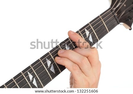 hand on fretboard - stock photo