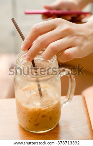 Hand on Glass of coffee , Warn summer color style .