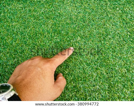 hand on grass background