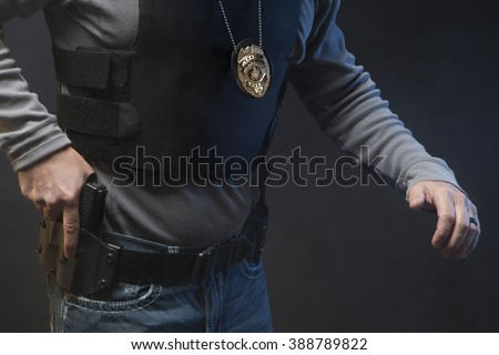 Hand on gun in holster.  Undercover Law Enforcement Special Agent with weapon. - stock photo