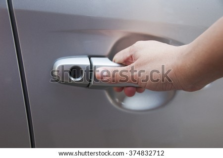 Hand on handle. Close-up opening a car door