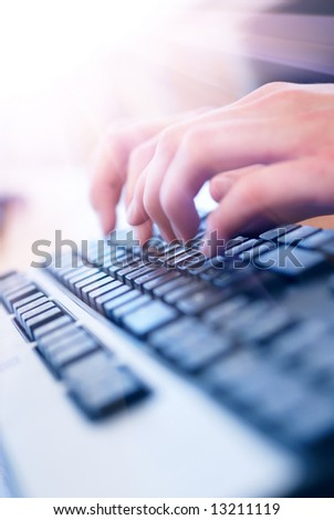 hand on keyboard - stock photo