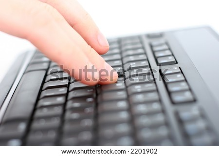Hand on keyboard, shallow DOF - stock photo
