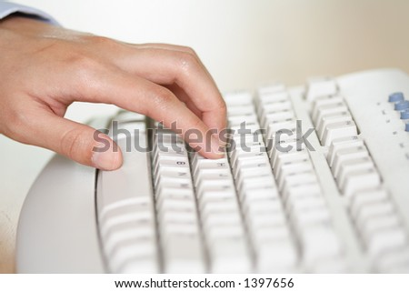 Hand on keyboard typing