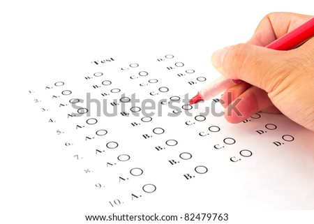 Hand on red pen choosing the test list on the examination - stock photo