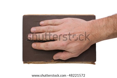 hand on the book isolated on white background - stock photo