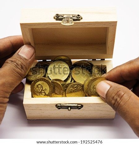 Hand open the coin box - stock photo