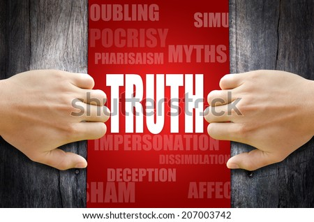 """Hand opening a wooden door found the word """"TRUTH"""" in the middle of many different words. - stock photo"""