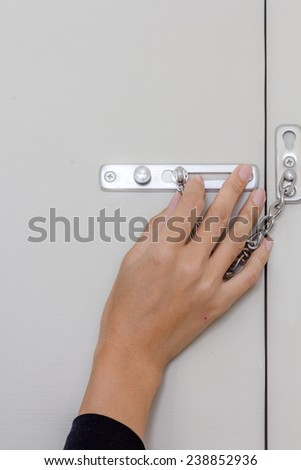 hand opening door lock in the room - stock photo
