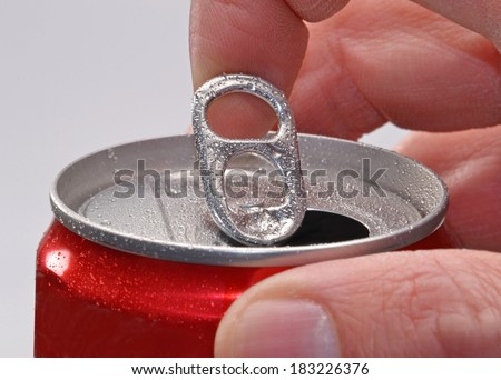 Hand opening soda can. - stock photo