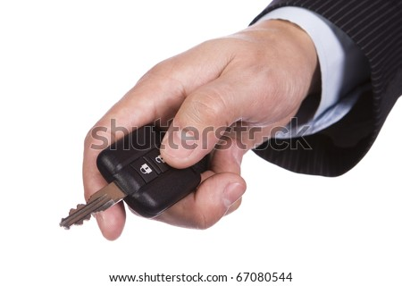 Hand opening the car door with a remote control - stock photo