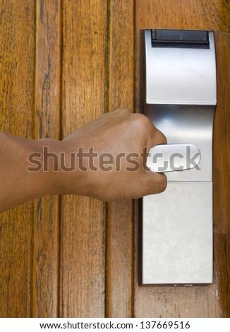 Hand opening the door in hotel. - stock photo