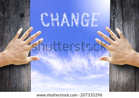 "Hand opening the wooden door and see ""CHANGE"" text cloud in the Sky. - stock photo"