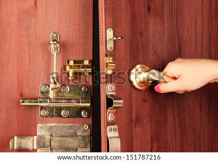 Hand opens door close-up - stock photo