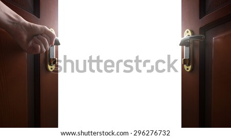 hand opens empty room door - stock photo
