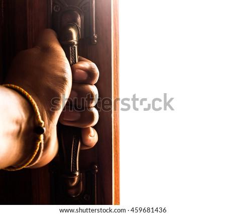 hand opens empty room door - stock photo