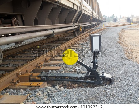 Hand-operated railroad switch with lever, weight and signal - stock photo