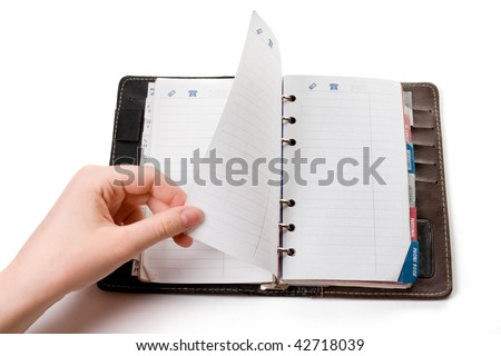 Hand paging through open empty notebook - stock photo