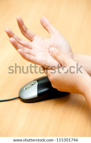 hand pain from mouse - stock photo