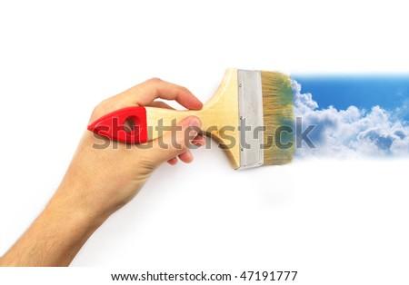 Hand paint the sky. Conceptual design. - stock photo