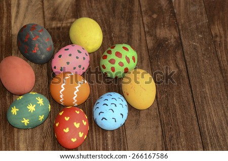 Hand painted and decorated eggs celebrating Easter / Easter eggs / Using non-toxic homemade paint and whole family joining in the fun - stock photo