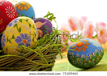 Hand painted beautiful  colorful  easter eggs in wicker basket - stock photo