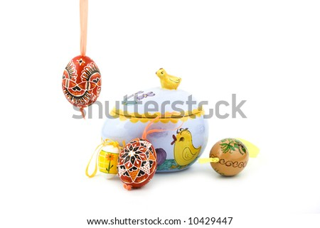 hand painted Easter egg and decorated dose isolated on white background