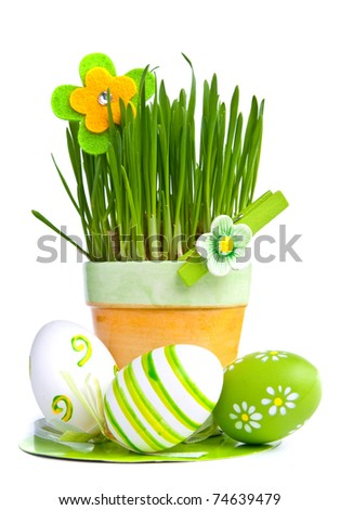 Hand painted Easter eggs and grass isolated on white background - stock photo